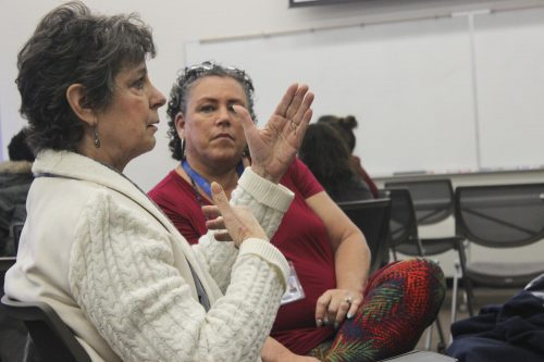 Beth Madigan, Administrator Assistant for the Vice president, (front) and Robin Neal, Vice President of Student Services(back), expressing their thoughts and views on the discussion at the hate and bias workshop Dec. 3, 2018 (Photo by Breawna Maynard)
