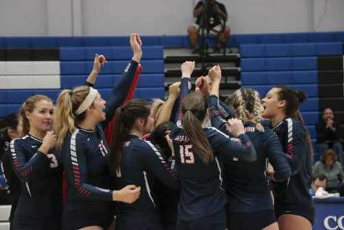 The American River College volleyball team celebrates their 3-1 win against El Camino College in the quaterfinals of the CCCAA State Chmpionship tournament at Solano College on Nov. 30, 2018. ARC moved on to place first in the tournament. (Photo by Jennah Booth)