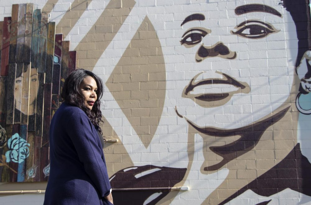 Activist Ebony Harper stands in front of the mural that she helped fund behind the Lavender Library in Sacramento, Calif. on Nov. 30, 2018. (Photo by Ashley Hayes-Stone)