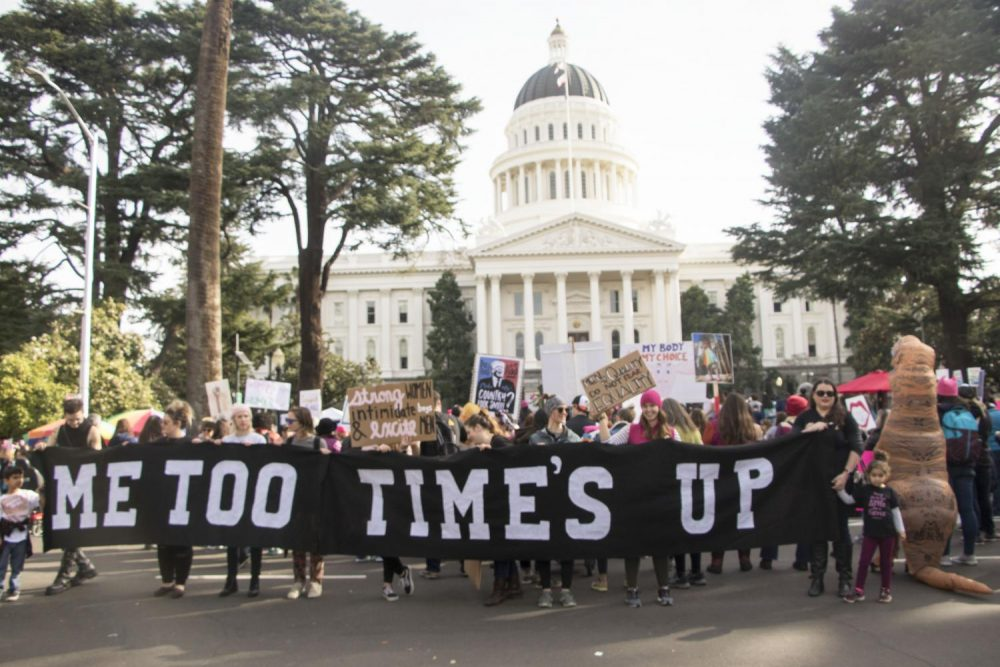 Demostrators+hold+up+a+banner+that+reads+%22Me+Too+Time%27s+Up+in+front+of+the+California+State+Capitol+during+the+third+annual+Women%27s+March+in+Sacramento%2C+Calif.+on+Jan.+19%2C+2019.+The+number+of+attendance+decrease+from+last+year%27s+event+according+to+Sacramento+Police+10%2C000+individuals+participated+in+the+march+than+the++estimasted+36%2C000+marchers+that+attended+last+year.