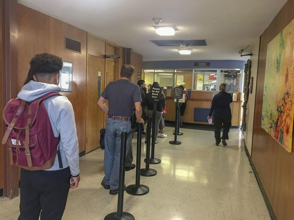American River College students wait in line to get a parking permit and pay their semester fees at the Business Services office on Jan. 30, 2019 (Photo by Hameed Zargry)