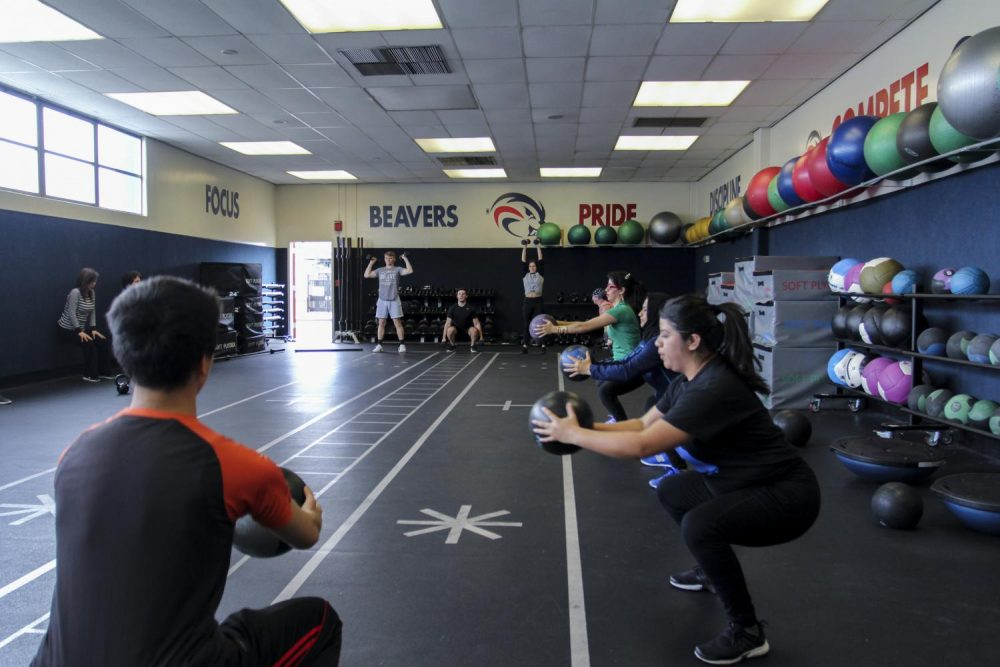 Fitness 321 students strengthen their core during class at American River College on Feb. 27, 2019. (Photo by Katia Esguerra)