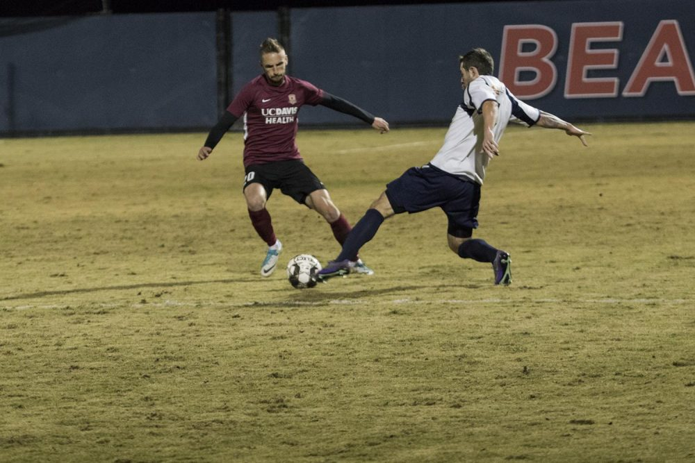 Sacramento Republic midfielder Villyan Bijen challenges the ball against a Sacramento Gold player during a preseason game at American River College on Feb. 9, 2019. Republic FC won the game, 5-0. (Photo by Ashley Hayes-Stone)