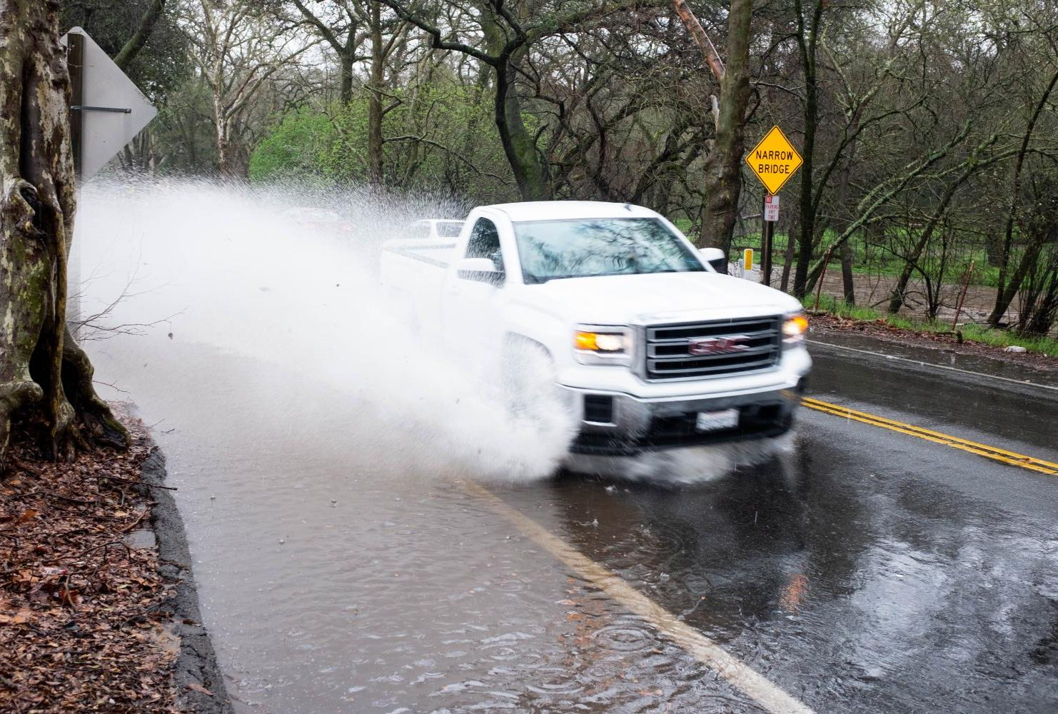 A section of road flooded leaving a puddle that extended into a lane of traffic on a section of Winding Way which runs alongside American River College on Feb. 26, 2019. (Photo by Patrick Hyun Wilson)