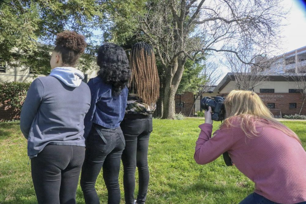 American River Current photo editor Ashley Hayes-Stone takes a photo for an article on hair texture that will be featured in this upcoming print edition that comes out Feb. 13, at American River College on Feb. 11, 2019. (Photo by Irene Jacobs)