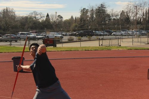 American River College student Davis Yasuda throws a javelin during practice on the football field at ARC on Feb. 20, 2019.(Photo by Anthony Barnes)