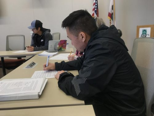 Director of Finance Dallas Vue adds notes to his agenda sheet at the Associated Student Body meeting at American River College on Feb. 22, 2019. (Photo by Alexis Warren)
