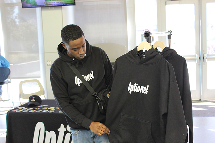 Former American River College student Austin Herell showcases his own clothing line named Optionel, in the student center on Feb. 19, 2019. (Photo by Breawna Maynard)
