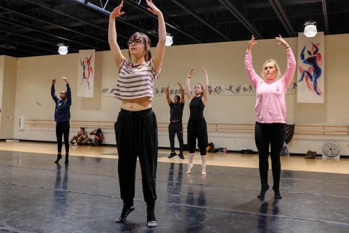Students in the Dance Production Studio & Stage class warm up before choreographing routines for the class in the dance studio, on Feb. 06, 2019. (Photo by Patrick Hyun Wilson)