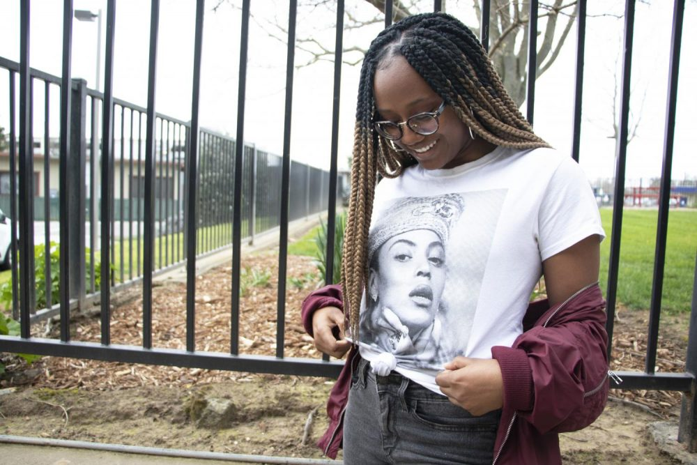Social Media Editor Alexis Warren wears a Beyonce shirt to honor her as one of the black icons that Warren looks up to during Black History Month on Feb. 25, 2019. (Photo by Ashley Hayes-Stone)