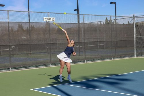 American River women's tennis player, Abby Garcia serves the ball on Feb. 19 at Folsom Lake College. ARC beat FLC, 9-0. (Photo by Hameed Zargry)