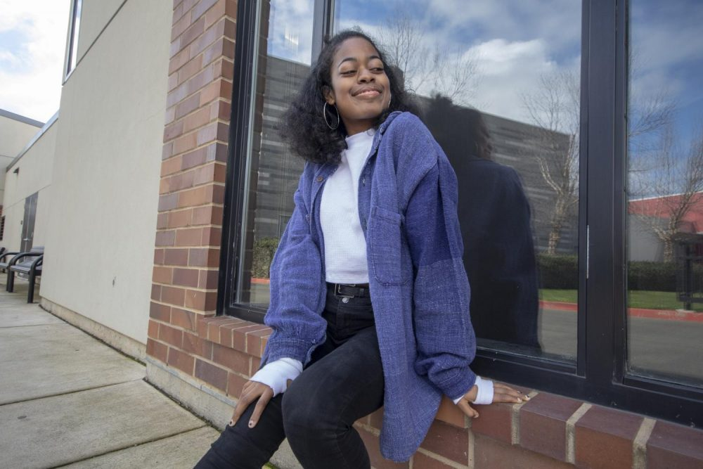 Opinion editor Imani Smith depends on thrifted items for a majority of her wardrobe. Thrifting clothing is a great way for college students to save money, while still looking trendy. (Photo illustration by Ashley Hayes-Stone)