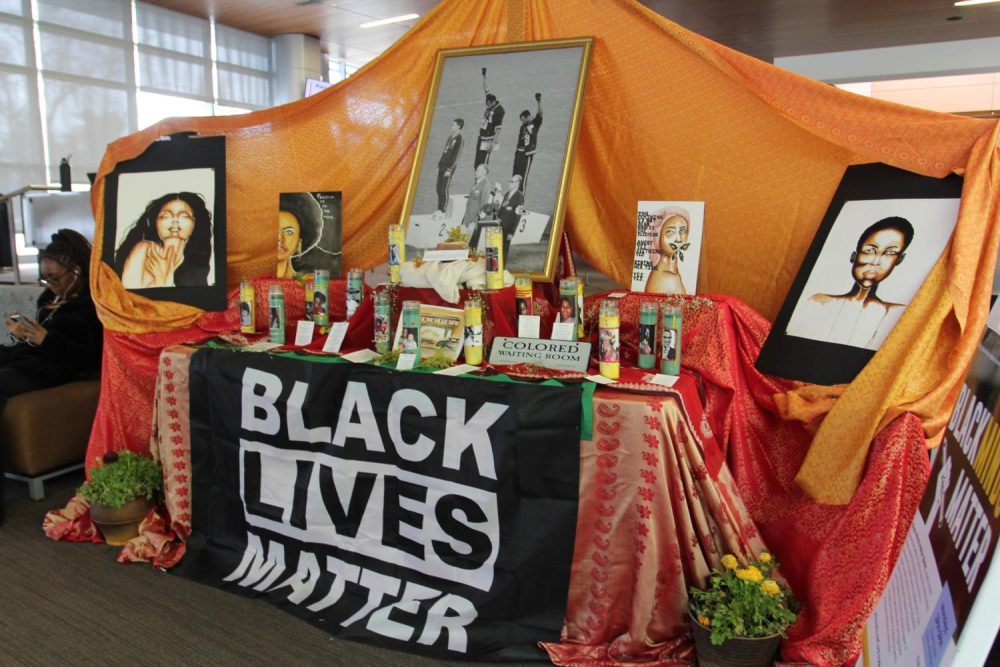 A table adorned with candles, a Black Lives Matter flag, and messages acknowledging and celebrating the lives of black Americans is set up in the Student Center. (Photo by Katia Esguerra)