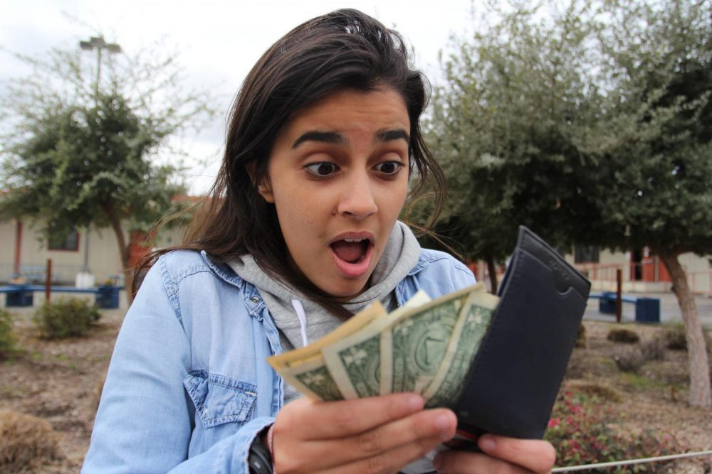 Staff writer Emily Mello is excited about the extra money she has in her wallet because of the American River College Promise Grant on March 3, 2019. (Photo by Katia Esguerra)