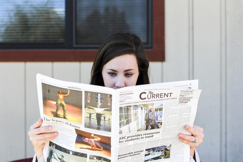 Ariel Casper keeps up with what's happening on campus, reading news that affect students, faculty and staff. (Photo illustration by Katia Esguerra)