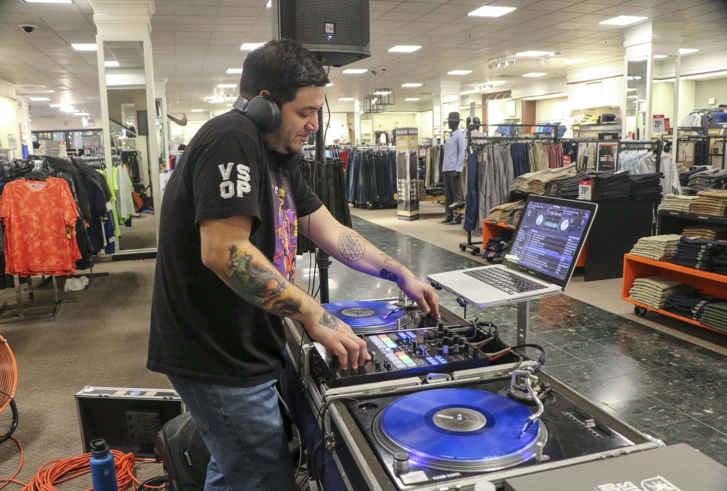 American River College music student Ricardo Preciado, or DJ Riktor, mixed music from his set-up in the JCPenney at Arden Fair Mall during the Suit Up Event on March 10, 2019. (Photo by Irene Jacobs)