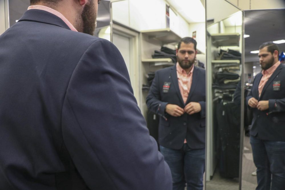 Engineering major Francisco Leon-Gomez tries on a suit during the first Suit Up Event, hosted by American River College's Career And Pathways Support Services on March 10, 2019. (File Photo)