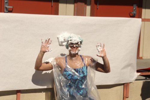 Mathematics assistant professor Helene Nehrebecki takes a pie to the face in honor of a Pi Day event hosted by the STEM Center, where students have the opportunity to throw pies at Nehrebecki and other professors at American River College to celebrate the never-ending constant used to find a circle's circumference on March 14, 2019. (Photo by Thomas Cathey)
