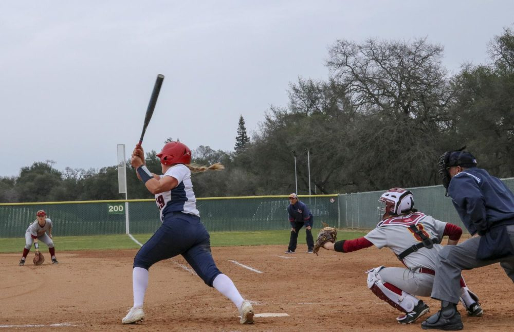 American River College softball outfielder Kirsten Cox swings and misses in the bottom of the fifth inning against Sacramento City at ARC. ARC lost 7-1. (Photo by Irene Jacobs)