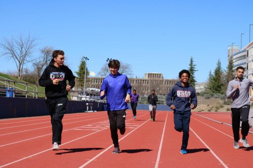 (From left to right) Runners Ricky Frank, Charles Pierce, Jordan Taylor and Zavier Beevers warming up at the start of practice. (Photo Illustration By Thomas Cathey)