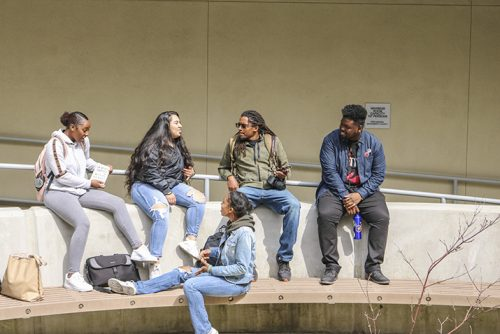 Umoja Sahku students, (From left to right) Mahogany McFarland, Kayla Sepulveda, Haven Bishop, Denzel Phoenix, and Sushiela King, all  hang out and connect between classes near the community rooms at American River College on March 19, 2019. (Photo by Breawna Maynard)