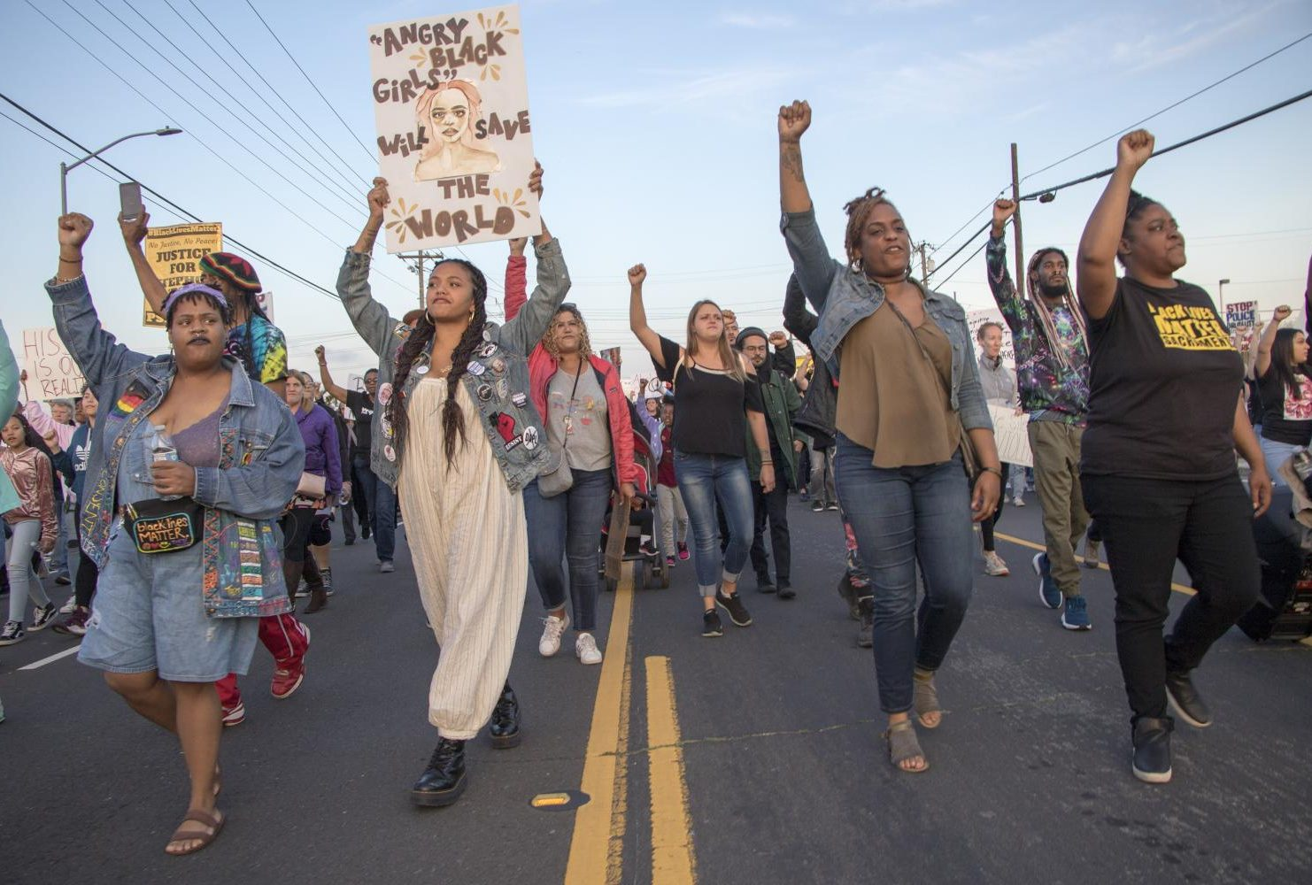Black Lives Matter Sacramento demonstrators hold their fists in the air as they march down Meadowview Road during the one year anniversary of Stephon Clark's death in South Sacramento, Calif. on March 18, 2019. (Photo by Ashley Hayes-Stone)