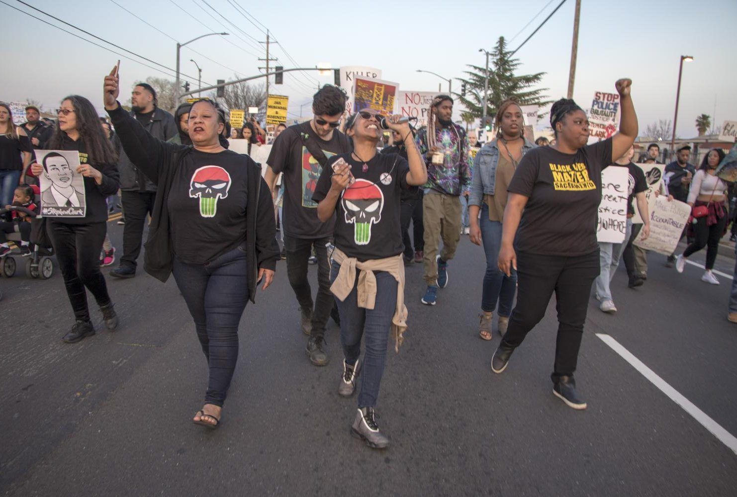 "Sacramento Black Lives Matter demonstrators lead the march while chanting ""Say his name"" as they continue to walk down Meadowview Road during the one year anniversary of Stephon Clark's death in South Sacramento, Calif. on March 18, 2019. (Photo by Ashley Hayes-Stone)"