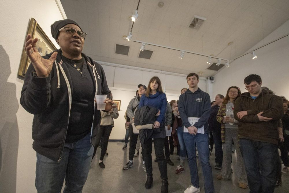 "Laney College art professor Fan Lee Warren speaks about her art show, ""Piece$"" which features her highly symbolic work in the James Kaneko Gallery at American River College on Feb. 28, 2019. (Photo by Ashley Hayes-Stone)"