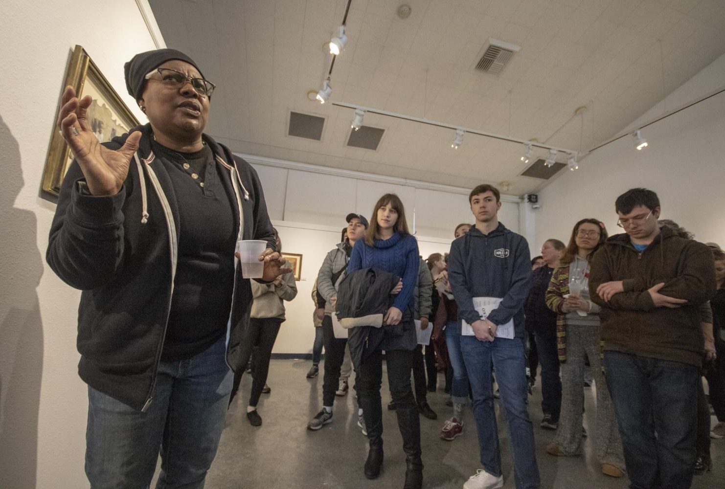 "Laney College art professor Fan Lee Warren speaks about her art show, ""Piece$"" which features her highly symbolic work in the James Kaneko Gallery at American River College on Feb. 28, 2019. (Photo by Ashley Hayes-Stone"