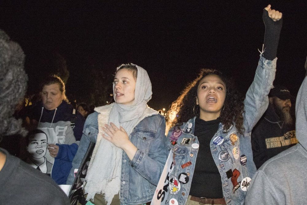 American River College U.N.I.T.E members Raven Kauba (left) and Dronme Davis (right) participate in a Stephon Clark protest on March 8, 2019. The two students were two of the 84 demonstrators who were arrested by Sacramento police officers during a Stephon Clark protest in East Sacramento on March 4, 2019. (Photo by Ashley Hayes-Stone)