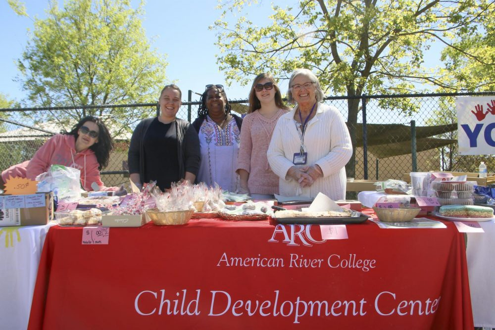 Fundraisers (from left to right) Zare Bell, Angela Gerasimenko, Cristal Johnson, Anastasiya Danylevych and Sue Ahola from the Child Development Center host a bake sale to raise money to take care of the center's pets at American River College on April 9, 2019. (Photo by Alexis Warren)