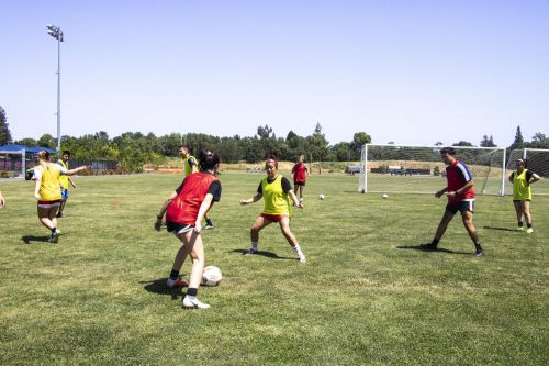 Students practice soccer drills on the American River Collge soccer field during their off season on April 29, 2019. (photo by Katia Esguerra)