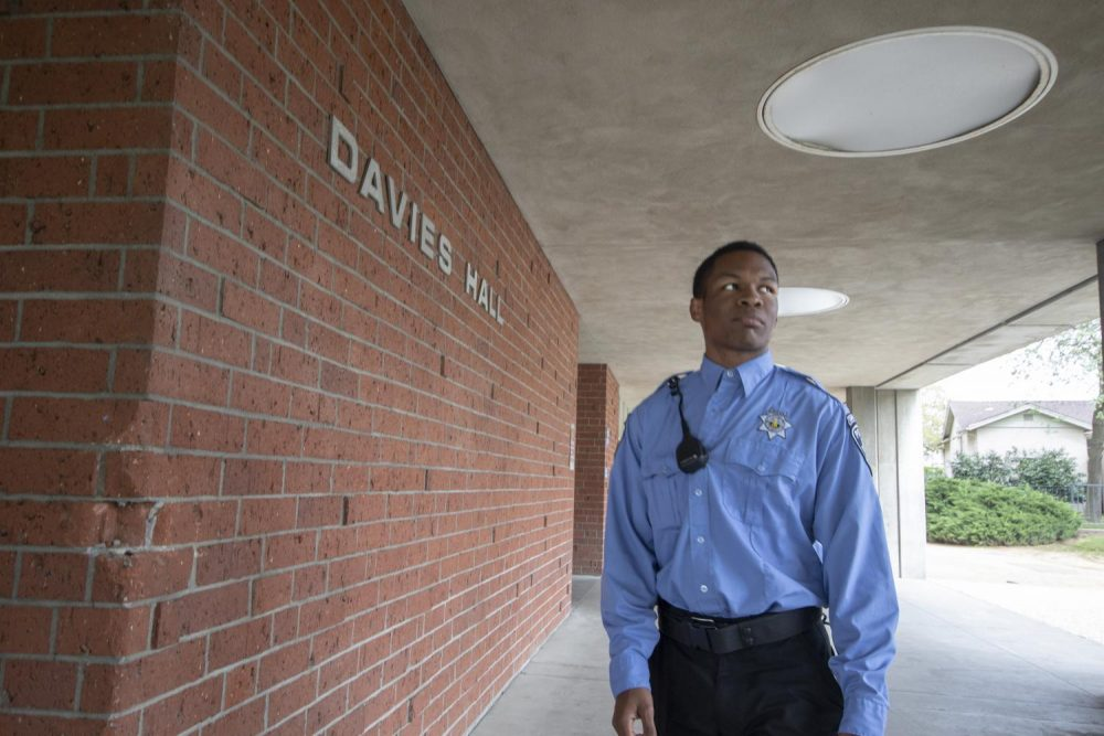 Campus patrol officer Joshua Harris walks the perimeter of Davies Hall to ensure the safety of the campus at American River College on April 3, 2019. (Photo illustration by Ashley Hayes-Stone)