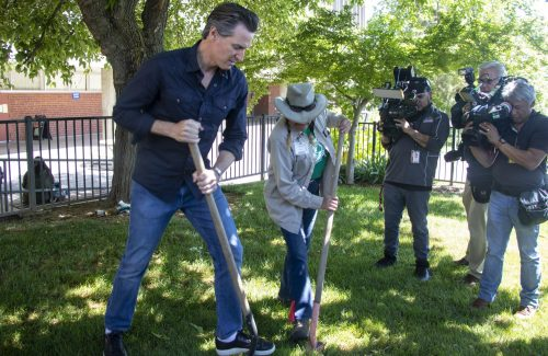 California Governor Gavin Newsom job shadows American River College Groundskeeper Brenda Baker as she replaces a sprinkler head in front of the Ranch House during International Workers' Day on May 1, 2019. (Photo by Emily Mello)