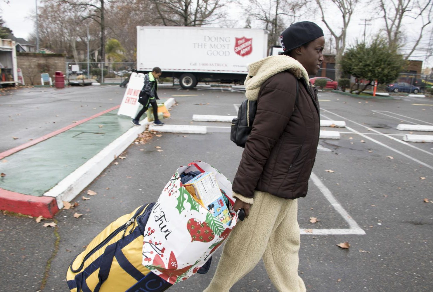 After checking out of the motel, Duren-Hill and her son make their way to The Salvation Army to get a new suitcase and some clothes for themselves in Sacramento, Calif. on Jan. 5, 2019. (Photo by Ashley Hayes-Stone)