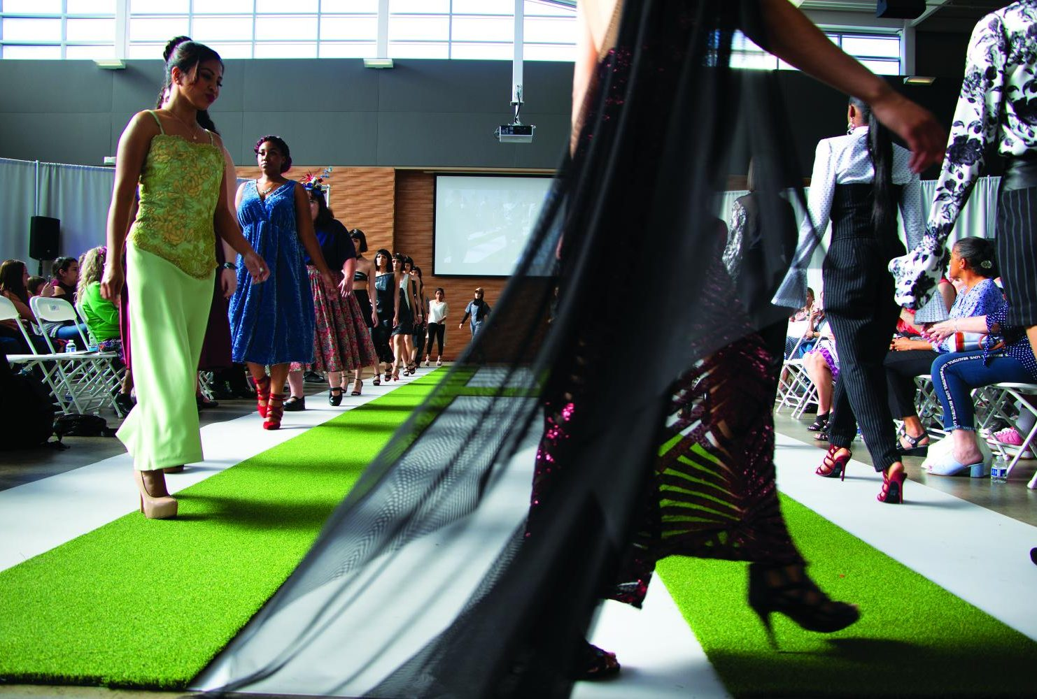 """Models walk the runway in the Student Center during the finale of the 18th annual fashion show """"Homogany"""" put on by the American River College fashion department on May 4th, 2019. (Photo by Ashley Hayes-Stone)"""