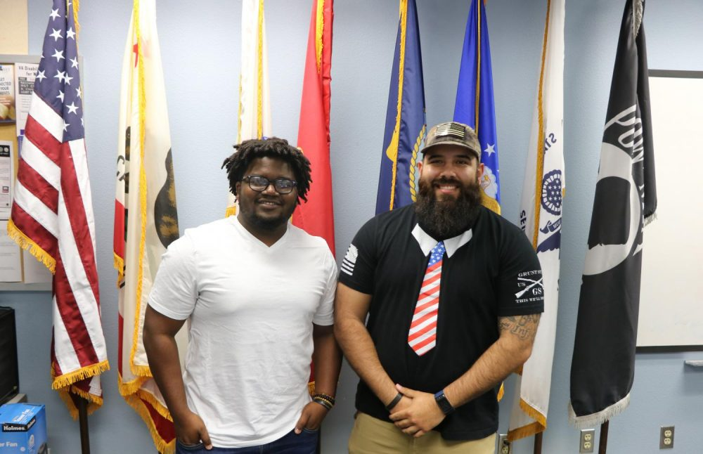 Former military members Eugene Dehoney (left) and Jose Bueno (right) pose for a picture at the Veterans Resource Center at American River College on May 1, 2019. (Photo by Anthony Barnes)
