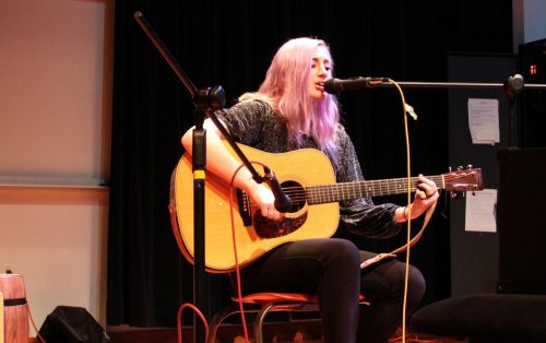 American River College music student Riddle Anne performs an original song for the ARC Acoustic Cafe on March 1, 2019. (photo by Ariel Caspar)