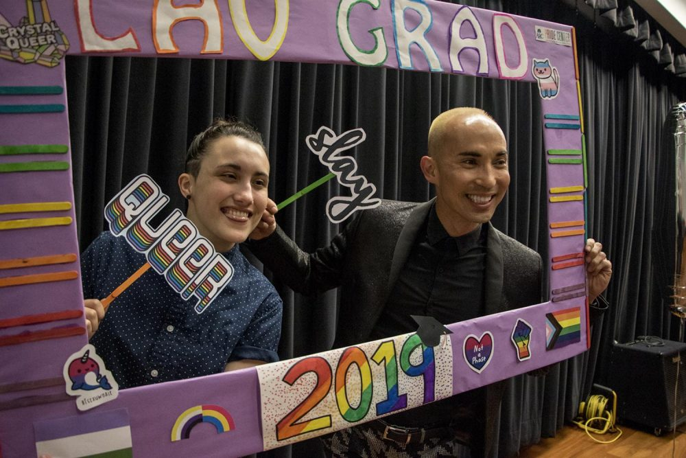 Pride+Center+student+mentor+Tori+Miller+and+Equity+Programs+and+Pathways+Dean+Joshua+Moon+Johnson+pose+with+a+prop+frame+at+the+ceremony+on+May+3%2C+2019.+%28Photo+by+Ashley+Hayes-Stone%29