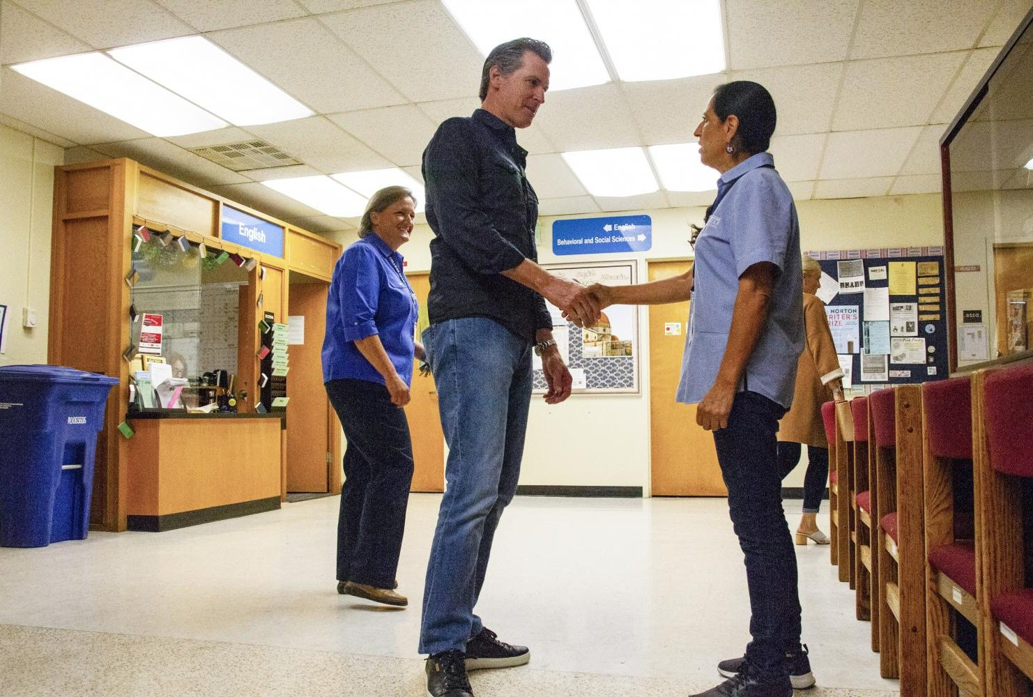 Gavin Newsom meets American River College custodian Maria Arambula on the third floor of Davies Hall at American River College for International Workers' Day May 1, 2019. (Photo by Patrick Hyun Wilson)