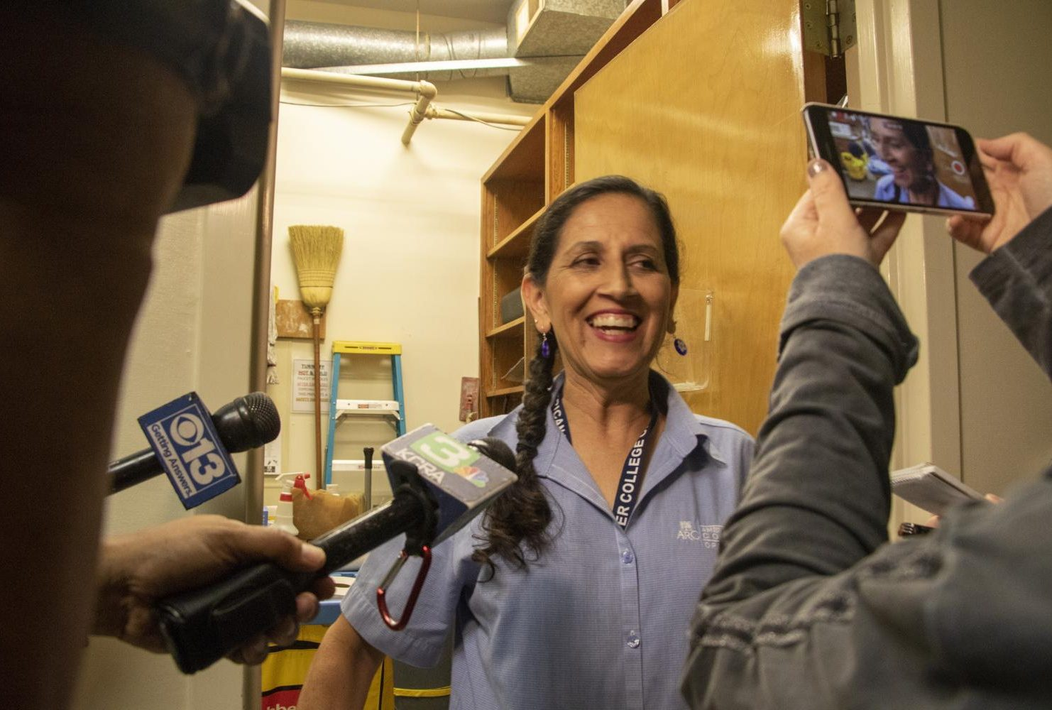 American River College custodian Maria Arambula gets interview by the local media before being job shadow by Calif. Governor Gavin Newsom during International Workers' Day on May 1, 2019. (Photo by Ashley Hayes-Stone)