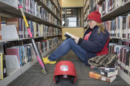 American River College softball player Celine Castonguay uses the campus library as a second home to study in between classes and her softball practices. (Photo by Ashley Hayes-Stone)