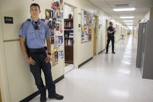 Campus patrol officer Giovani Spinazze and Los Rios Community College officer Joe Quirarte patrol the hallways of Davies Hall during Calif. Governor Gavin Newsom visit to American River College on May 1, 2019. (Photo by Ashley Hayes-Stone)