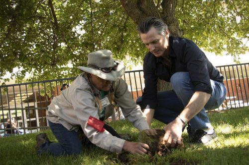 California Governor Gavin Newsom assists American River College groundskeeper Brenda Baker with fixing a sprinkler outside of the Ranch House during International Workers' Day on May 1, 2019. (Photo by Ashley Hayes-Stone)