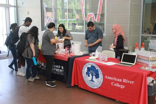 To kick off the new semester and promote their organization, the American River College Associated Student Body hands out free ice cream sundaes to students in the Student Center at ARC on Aug. 27, 2019.  (Photo by Thomas Cathey)