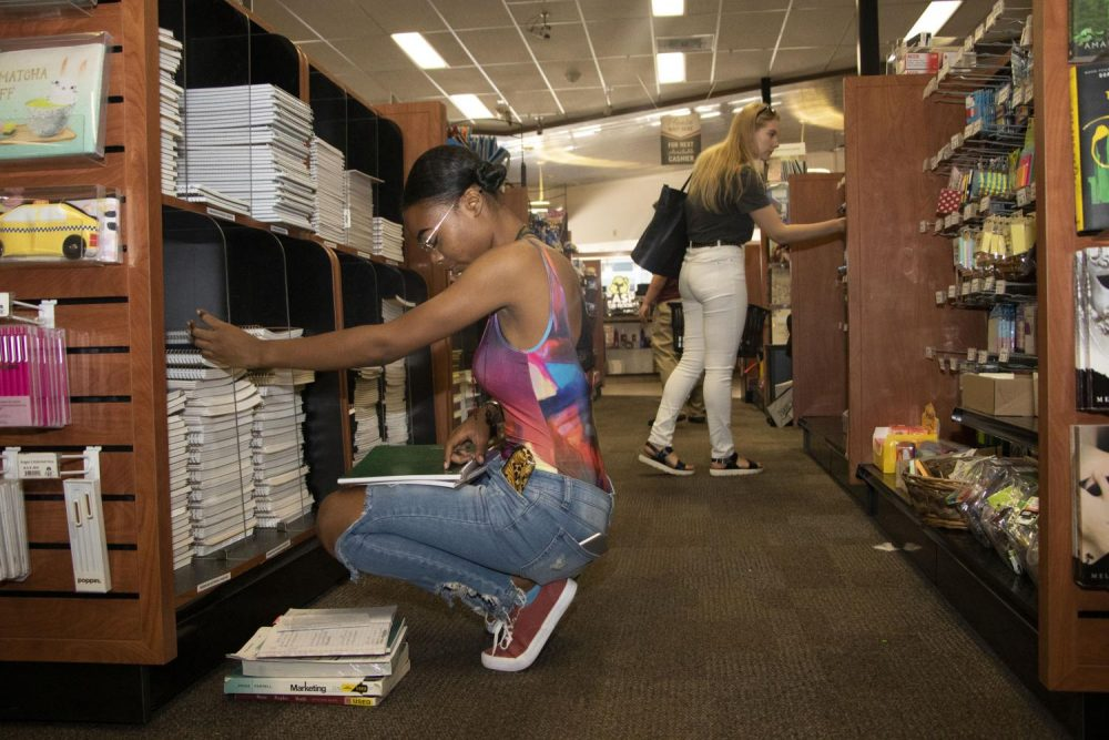 Business major Antahnia Watson and nursing major Hannah Zakharaza shop at the Beaver Bookstore during the first day of school at American River College on Aug. 26, 2019. (Photo by Ashley Hayes-Stone)
