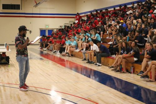 Kelvin Burt, instructional assistant for the Dusty Baker Center at American River College, reads off last year's accomplishments of ARC's student athletes at the main gymnasium at ARC on Aug. 30, 2019. (Photo by Thomas Cathey).