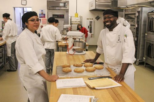 Culinary majors Andrea Valdez and Preston Reid prepare multigrain rolls for sandwiches for the Oak Cafe in Hospitality Management 320, Beginning Baking class taught by Judy Parks at American River College on Sept. 18, 2019. Today is the semester opening of the student run Oak Cafe and all proceeds go back to the Culinary Department. (Photo by Oden Taylor)