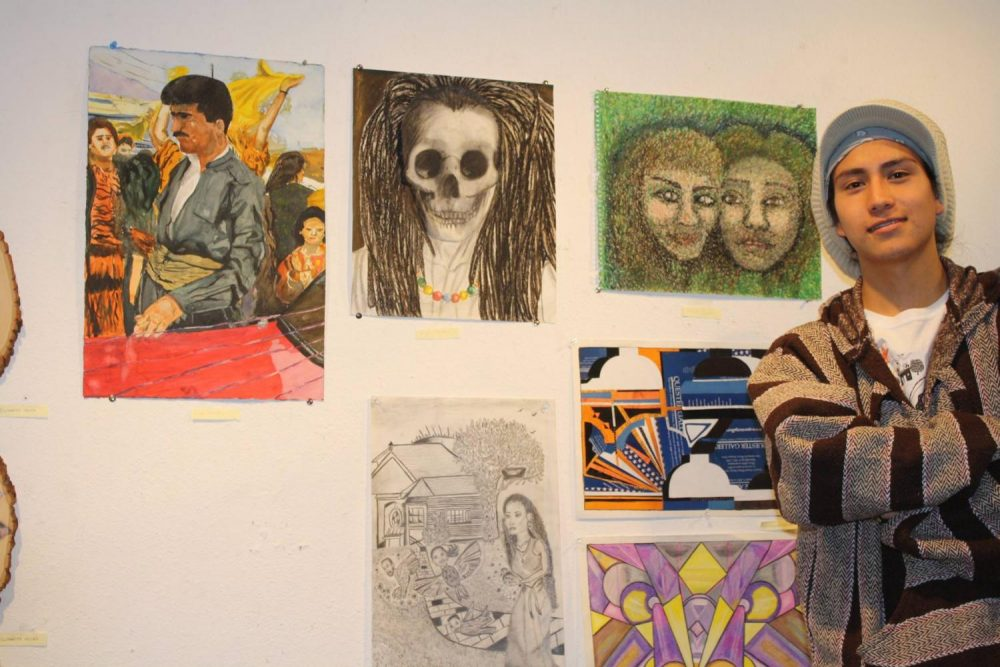 Art New Media student Miguel Gonzalez-Miranda, pictured here standing next to his works at the James Kaneko art Gallery at American River College in 2014, was detained by Immigration and Customs Enforcement agents on June, 2019. (File Photo)