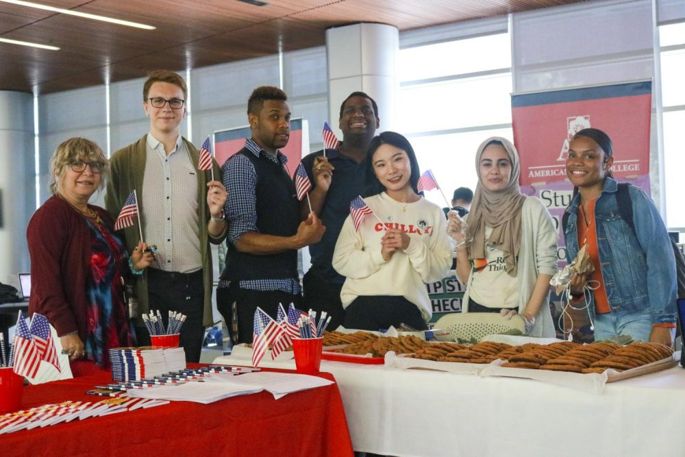 For Constitution Day, the Associate Student Body Senate lead by Student Senate President Aesha Abduljabbar, handed out fresh baked cookies and mini copies of the Constitution to passing students in the Student Center on Sept. 17. (Photo by Ariel Caspar)